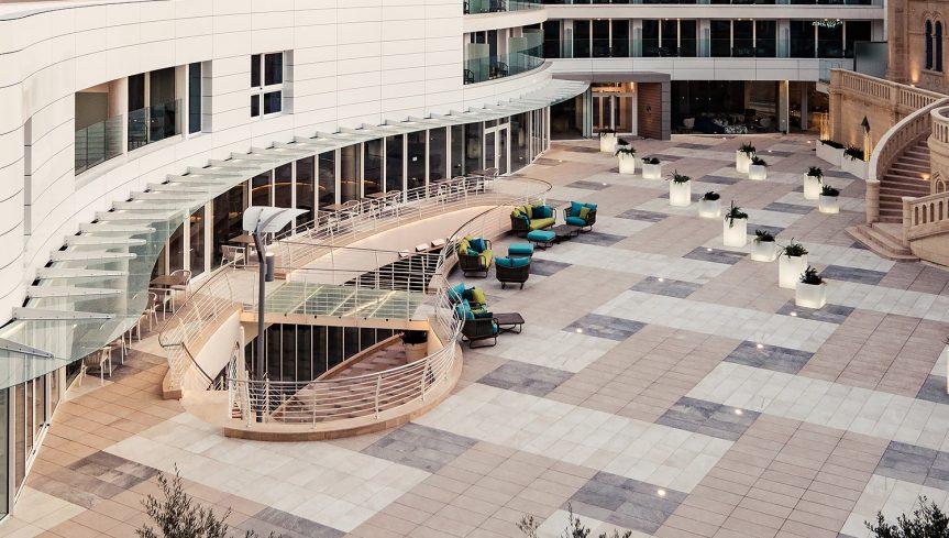 Varaschin - Hyatt Regency Hotel Malta | Babylon lounge armchairs, sofas, coffe tables and pouf in hotel courtyard
